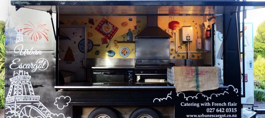 Showing the elegant black food truck with Eiffel tower painting : Food Truck Catering from Urban Escargot