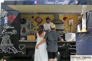 a wedding couple in front of food truck