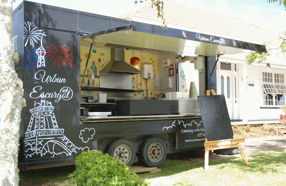 corporate catering with Urban Escargot food truck with menu blackboard outside