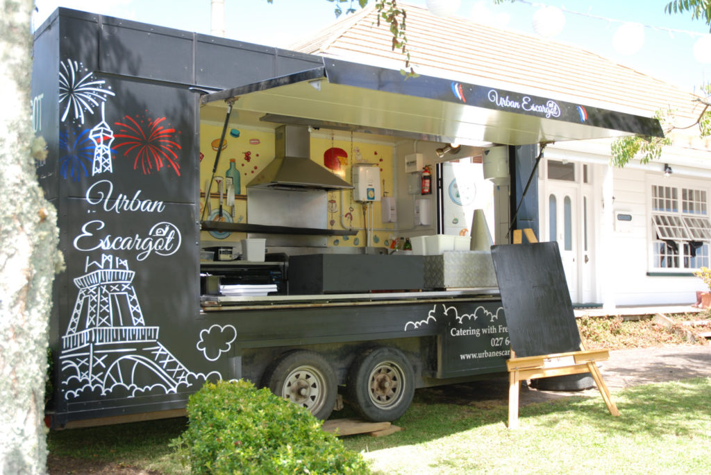 Street Food Style Wedding | Urban Escargot Black Food truck with blackboard outside ready for a special event